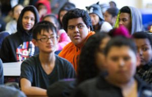A group of sophomore students, including sophomore Oscar Anaya, during an assembly at Rainier Beach High School on February 26th, 2015. The successful International Baccalaureate program at Rainier Beach High School is run by IB coordinator Colin Pierce.