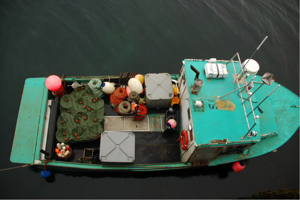 A small-scale owner-operated fishing vessel rigged with bottom longlines to catch groundfish such as haddock.